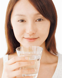Photo: A woman witha glass of water.