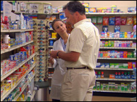 Photo: A pharmacist assisting a customer