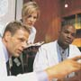 Photo: Healthcare professionals looking at monitor
