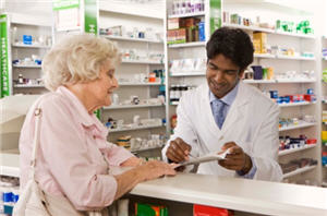 A pharmacist counsels an older adult about appropriate medication use