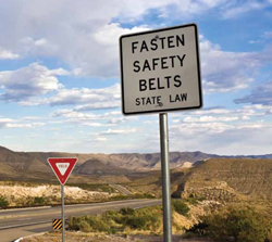 "Photo: Sign saying ""Fasten Safety Belts - State Law"""