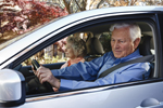 Photo: older adult couple in a car