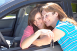 Photo: teen girl holding car keys hugging her mom