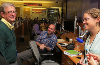 Morgan Hennessey (pictured center) works with a team of epidemiologists in the Emergency Operations Center at CDC's Atlanta headquarters