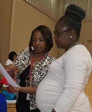 Lisa Moore, Community Health Director for District 1 (left) provides Zika prevention information during the Grenada Health Summit on April 1, 2017.