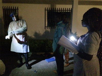 The infection control training in Guinea didn't stop when the sun went down. The students were so anxious to practice what they learned that they often stayed late into the evening using flashlights and the lights from their cell phones.
