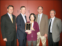 CDC researcher Dr. Claire Huang (center) receiving CO-LABS High Impact Research Award from Colorado Governor John Hickenlooper in November 2011