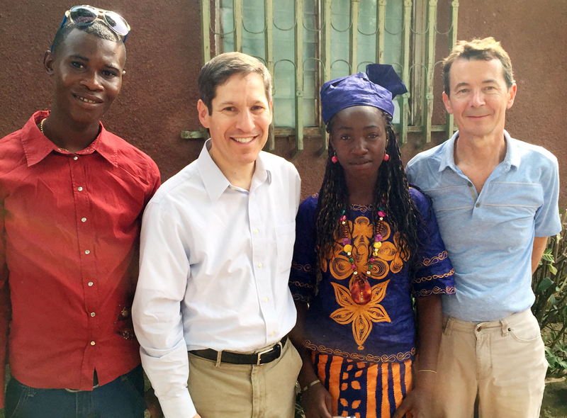 Dr. Frieden with two Ebola survivors in Guinea in December, 2014. Many survivors are now working to reduce survivor stigma.