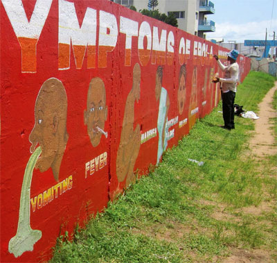Educational messages on Ebola are delivered in unique ways in Liberia. Here, a mural shows symptoms of Ebola.