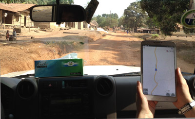 CDC responders Yoshinori Nakazawa and Jessica Hancock Allen used OpenStreetMap data on a tablet computer to help navigate to this small village between Kambia town and Kabaia in Kambia District, Sierra Leone.