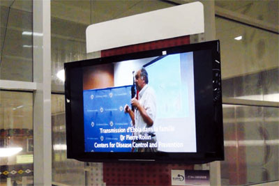 Ebola information in the Conakry, Guinea airport. This video features CDC Ebola expert, Dr. Pierre Rollin.