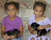 Photo: Two young girls with puppies