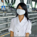 Photo: Health worker with a breathing  mask on