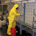 Photo: Worker in a hazard suit