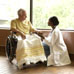 Photo: elderly individula with an assistant