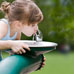 Girl child drinking from water fountain