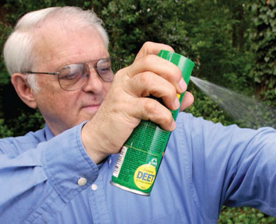Photo of a man using insect repellent. Hand washing and repellent can protect you from dangerous diseases.