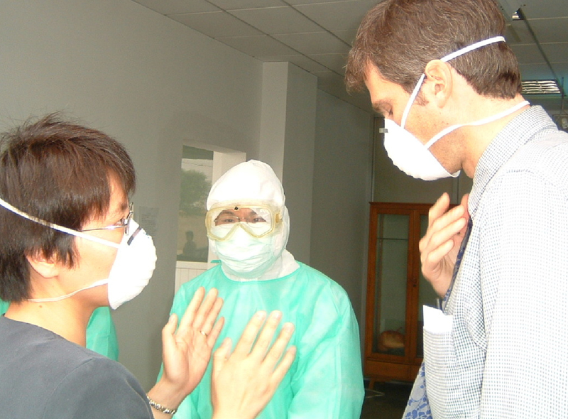 CDC epidemiologists Daniel Feikin and Fujie Xu at a fever clinic in Beijing, 2003