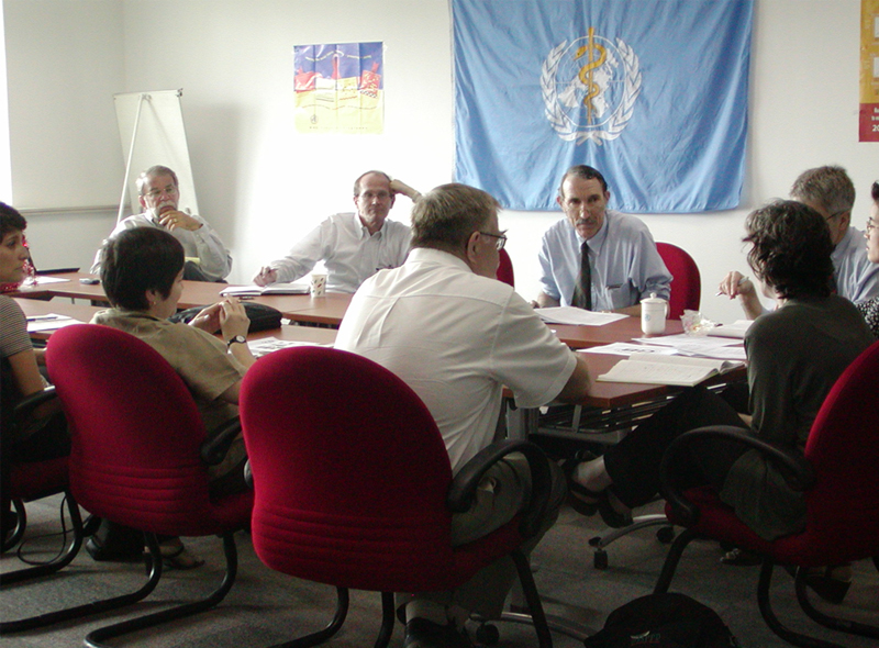 World Health Organization China Office – team lead meeting, May 2003. CDC's Anne Schuchat, MD, is seated at the head of the table (near right).