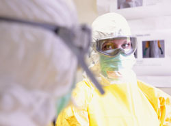 Scientist wearing personal protective equipment