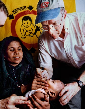 A baby receiving an oral polio vaccine.