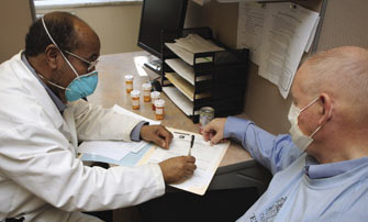 A healthcare professional consulting with a patient.