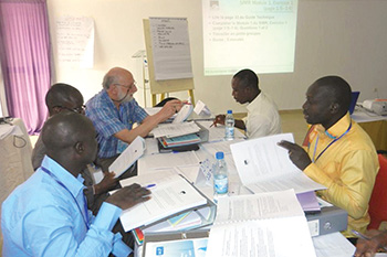 Dr. Eric Brenner, senior epidemiologist consultant, works through real-world disease monitoring exercises with FETP-STEP trainees in Cote d'Ivoire.
