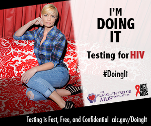 Actress Jaime Pressly wearing blue plaid shirt and jeans sitting on red velvet couch looking directly into the camera. We're Doing It. Testing for HIV. Testing is Fast, Free & Confidential. cdc.gov/DoingIt #DoingIt The Elizabeth Taylor Foundation, Act Against AIDS