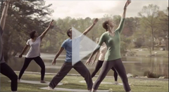 HIV Treatment Works Campaign PSA Video Thumbnail of Group Doing Yoga