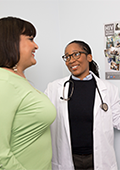 A photograph shows Jada, a transgender person, having a discussion with a health care professional.