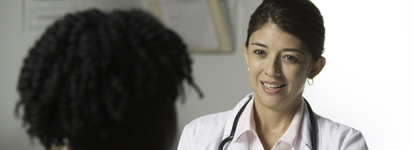 photo of a health professional consulting with a patient