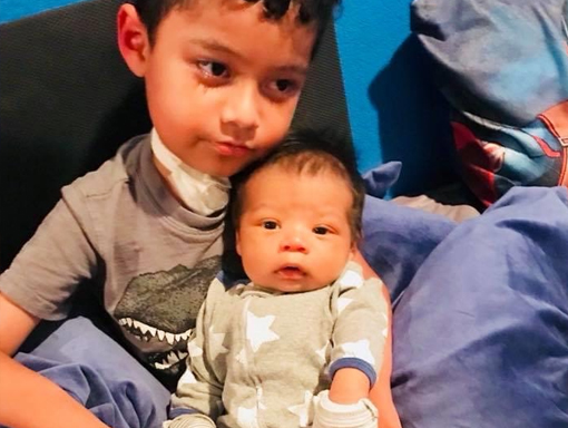 Francisco with his little brother.