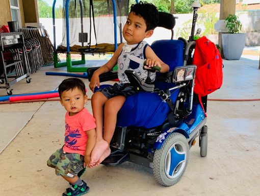 Francico in his powerchair with his little brother.