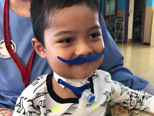 Francisco in the hospital wearing a fake moustache.