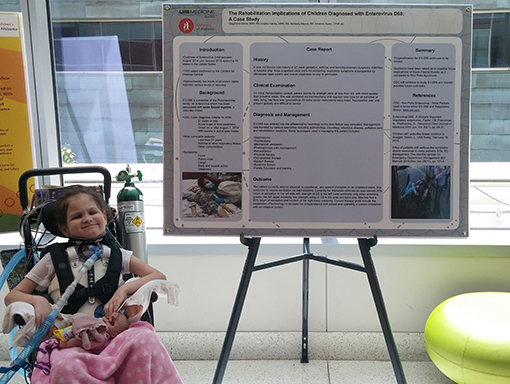 Kinley at a poster presentation.