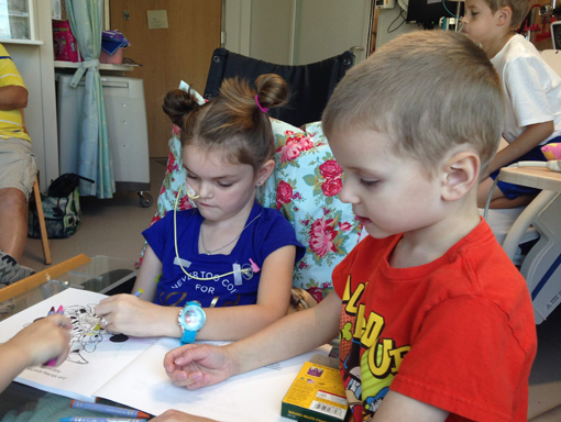 Lauren coloring with her brother.