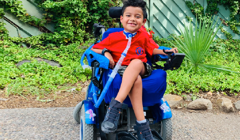 Francisco smiling in his power chair.