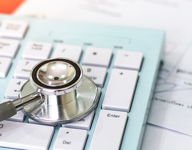 close up of a stethoscope on a laptop keyboard