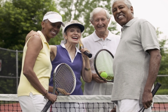 four people playing tennis