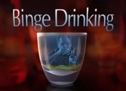 Binge Drinking video title with reflection in glass of man drinking alcohol