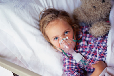 little girl getting breathing treatment