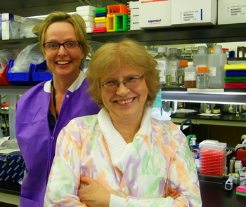 CDC microbiologists Olga Kosoy and Amy Lambert smiling into the camera.