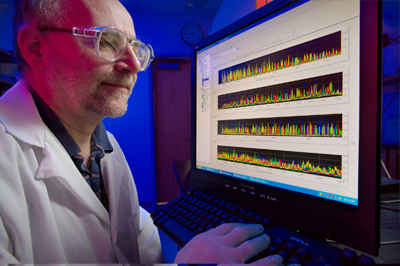 Scientist identifying pathogens on a computer screen.