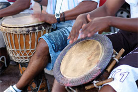group of people playing natural hide drums