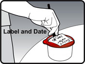 Image of person writing the date and description of contents on the label of a container that has leftover doxycycline and water mixture.