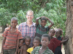 Epidemic Intelligence Service Officer Dr. Mark Lehman with children in eastern Zambia.