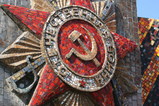 Soviet sigil featuring two stars, hammer and sickle