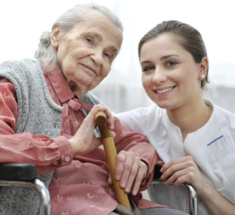 Photo: Nurse explaining to a nursing home resident about her antibiotic, how long it's needed and possible side effects.