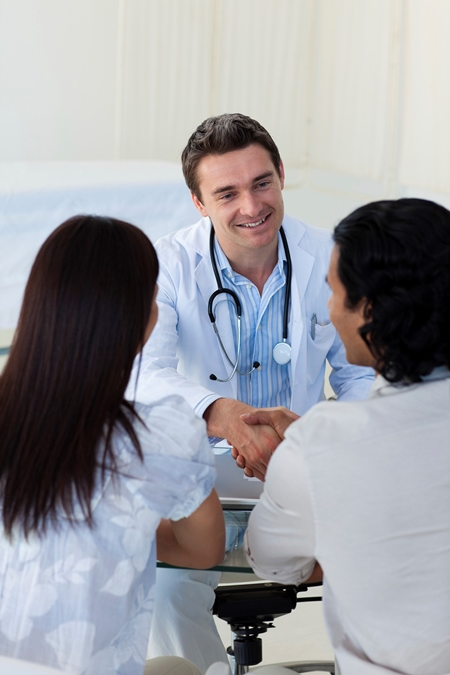 image of a physician talking with a couple