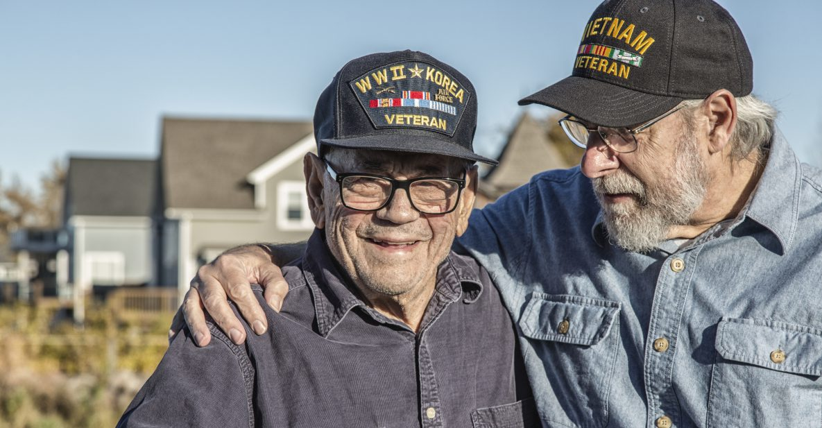 Two generations of war veterans embrace.